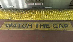NJTransit platform with 'Watch the Gap' sign