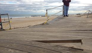 At first, Ocean Grove, N.J., failed to qualify for federal Sandy aid to repair its boardwalk. Above, a passerby surveyed the damage shortly after Sandy.