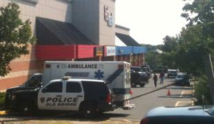 Police vehicles remain outside the Pathmark where a former employee allegedly shot and killed 2 co-workers.