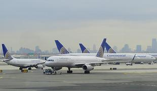 This November 24, 2009 photo shows Continental Airlines jets on the tarmac at Liberty International Airport in Newark, New Jersey. THe New York City skyline is in the background.