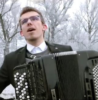Milan Řehák plays the accordion in a special outdoors performance of 'Winter.'
