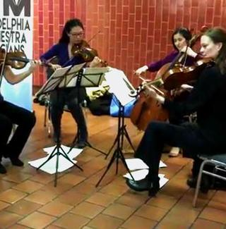 Members of the Philadelphia Orchestra in that city's Jefferson Station, playing fan-favorite 'Sleeper's Awake.'