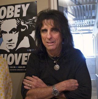 Alice Cooper and host Paul Cavalconte pose in the WQXR studio.