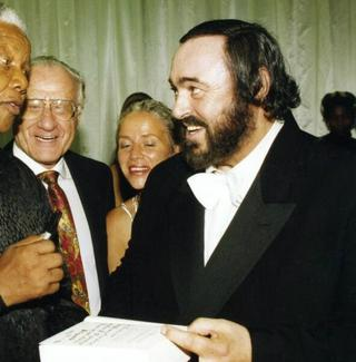 Nelson Mandela with tenor Luciano Pavarotti in an undated photo.