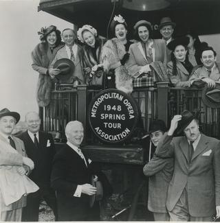 Metropolitan Opera company members board a train during the 1948 tour.