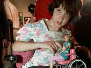 "Hannah Withers, who was 9 at the time,  at the unveiling of Mattel's 'Share a Smile Becky"" doll in 1997"