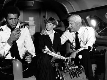 Kareem Abdul-Jabbar, L, and Peter Graves, R, in the 1980 film 'Airplane!'