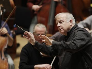 Detroit Symphony Orchestra Musical Director Leonard Slatkin leads the orchestra during a rehearsal in Detroit, Thursday, April 7, 2011.