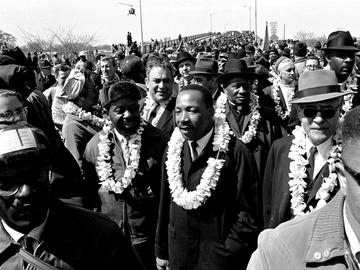 In this March 21, 1965 file photo, Martin Luther King, Jr. & his civil rights marchers cross the Edmund Pettus Bridge in Selma, Ala., heading for capitol, Montgomery, during a five day, 50 mile walk.