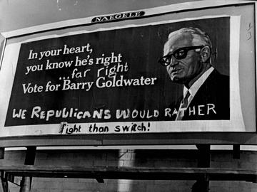 Partisans of both parties have been at work on the Barry Goldwater billboard at S. Dahlia St. and E. Evans Ave. 1964.