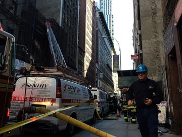 Rescue crews at the site of a fatal construction accident in Midtown in which an internal collapse killed one and seriously injured another worker.