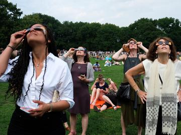 Watching the eclipse on August 21, 2017 in Central Park's Sheep Meadow.