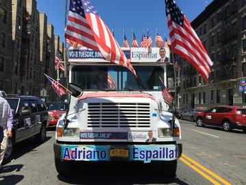 A bus that is driving around Upper Manhattan in support of State Senator  Adriano Espaillat's race for Charlie Rangle's congressional seat.
