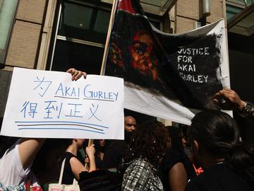 Supporters of Akai Gurley protested in front of the Brooklyn courthouse following a hearing for Officer Peter Liang
