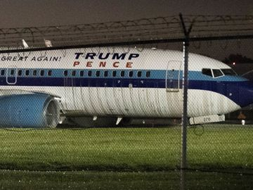 GOP vice presidential candidate Mike Pence's campaign airplane sits partially on the tarmac and the grass after sliding off the runway while landing at LGA Thu Oct 27, 2016