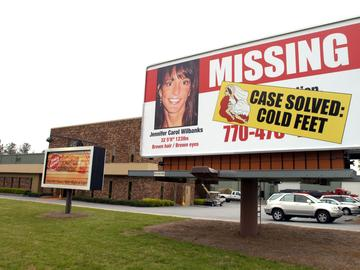 A billboard stands next to the road May 5, 2005 showing the changed status of Jennifer Wilbanks in Duluth, Georgia.