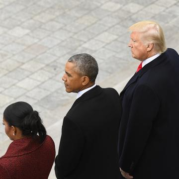 Former President Barack Obama and his wife Michelle Obama stand with President Donald Trump and his wife Melania Trump on the East front of the Capitol Hill in Washington, Friday, Jan. 20, 2017.