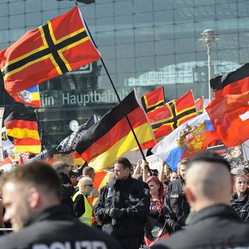 Far right-wing demonstrators gather in front of Hauptbahnhof railway station to protest against German Chancellor Angela Merkel's refugee policy on May 7, 2016 in Berlin, Germany.