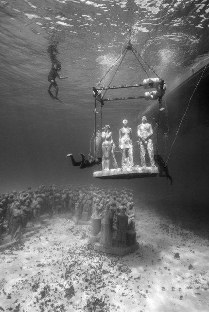 A sculpture is lowered into place on the ocean floor Jason deCaires Taylor