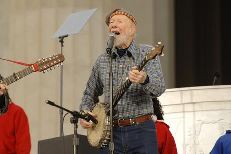 "Pete Seeger leads the crowd in singing ""This Land Is Your Land"" at the celebration for the inauguration of President Barack Obama."