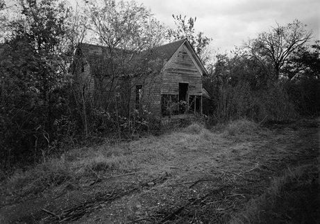 Woody Guthrie's Birthplace in Okfuskee County, Oklahoma in October 1979.  Guthrie was born into a middle-class family that fell on hard times during the Great Depression.