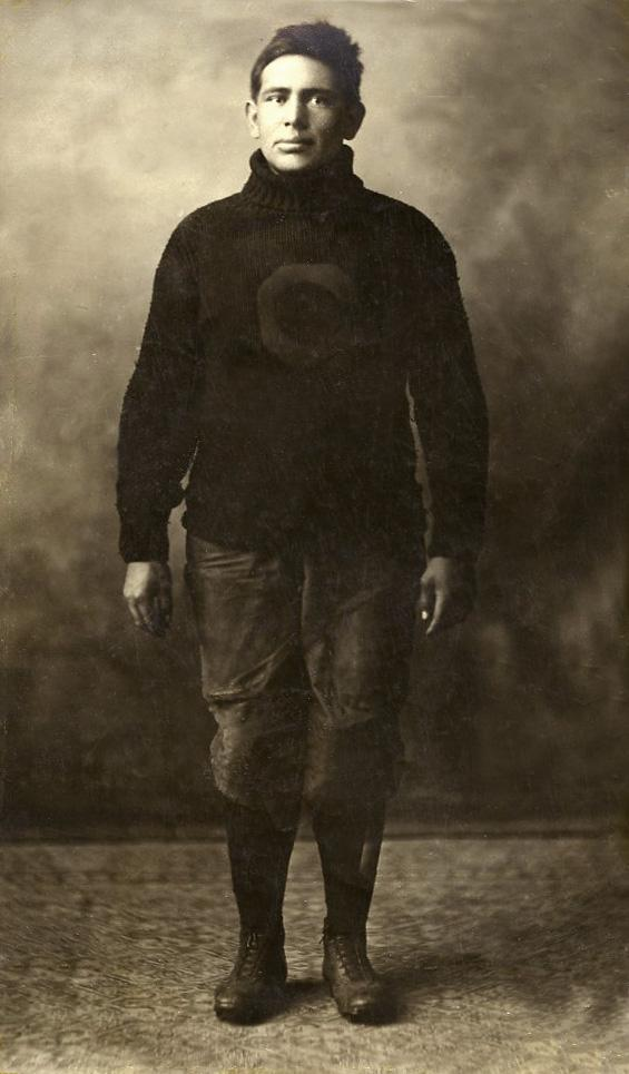 Peter Hauser, fullback, in football uniform.