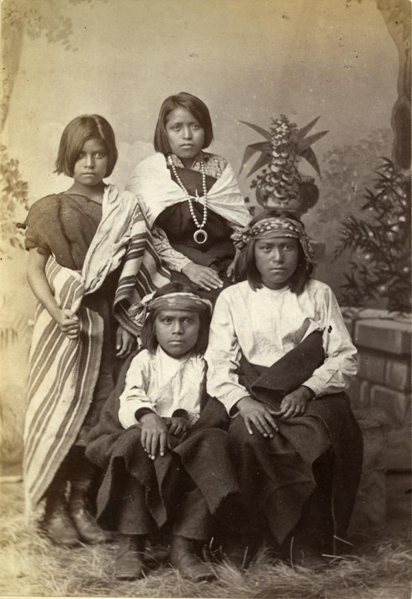 Four Pueblo children from Zuni, N.M., c. 1880.