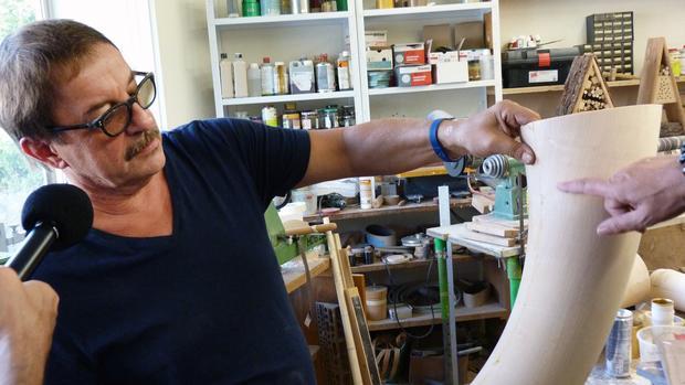 Alphorn maker Tobias Bärtschi at his workshop in Switzerland.