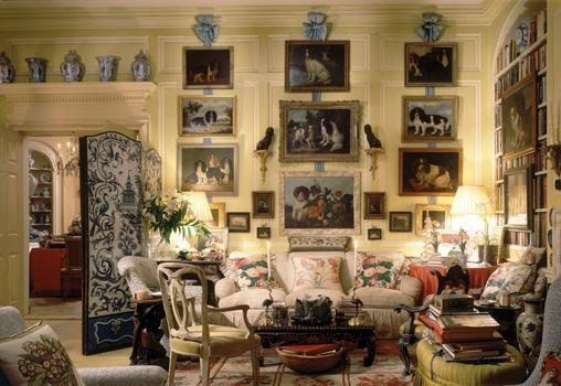 Buatta's living room features a collection of dog paintings, blue and white porcelain, and, of course, chintz.
