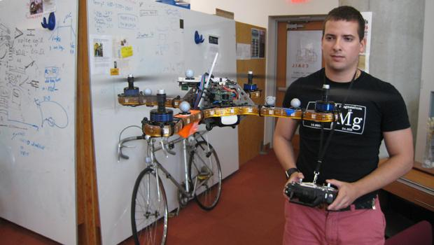 Engineer Daniel Soltero flies a drone in the Distributed Robotics Lab at MIT.