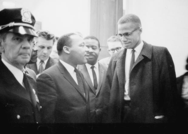Martin Luther King and Malcolm X waiting for press conference