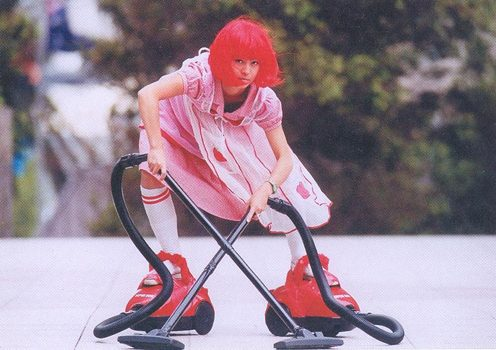 Supersucker New, 2001 by Toast Girl. Roller-skate vacuum cleaners have become a staple prop in the artist's repertoire.