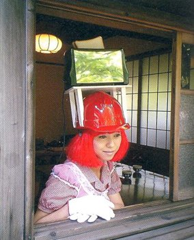 Toast Girl at the window, 2004. The artist's name was coined in 1998 when, as an exchange student in Australia, she decided to toast a piece of bread while holding the toaster on her head.