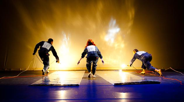 Whoosh! Pilobolus simulates the blazing brightness of a sunrise seen from space.
