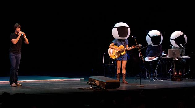 Comedian Demetri Martin has rocker Thao Nguyen and Jad & Robert blindfolded as the audience gets their LEDs ready.