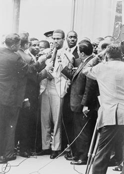 Malcolm X with reporters