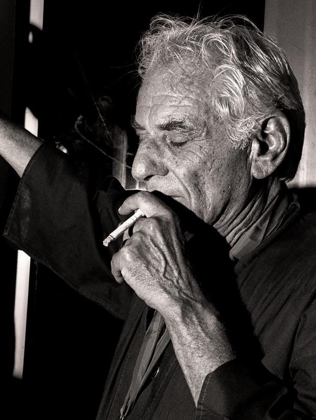 Leonard Bernstein smokes a cigarette.