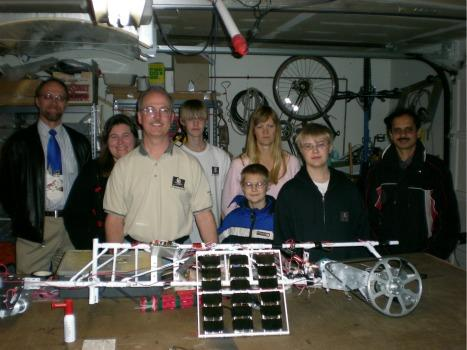 Brian Turner and his motley crew of Space Pirates pose in their garage with their solar-powered climber.