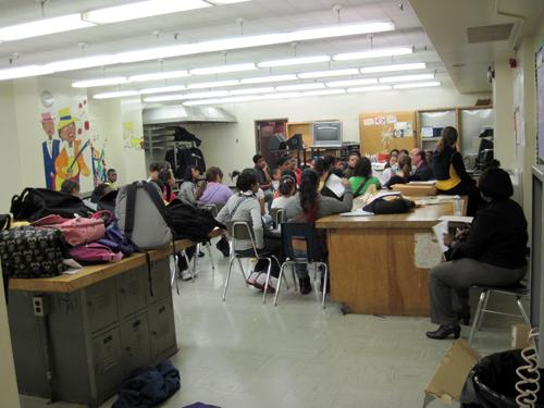 I.S. 217 is called the School of Performing Arts. Students in the chorus practice in a former shop room.