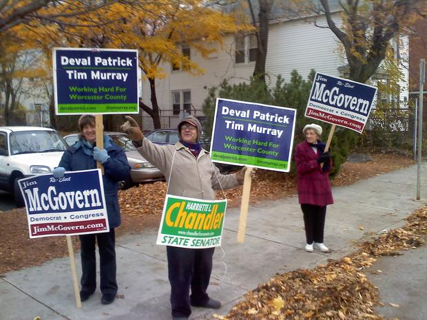 Democrats holding signs in front of Worcester MA Ward 10 Precincts 1 & 3
