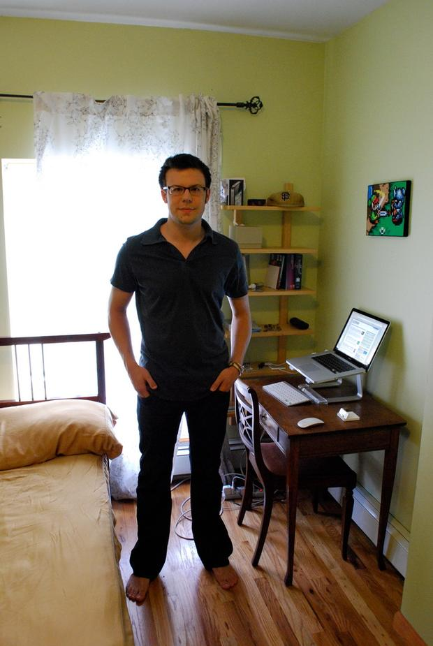 Kelly Sutton in front of some of his remaining possessions