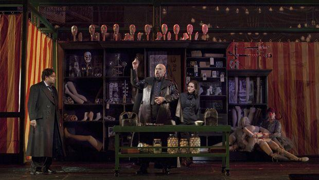 """A scene from Act I (Olympia act) of Offenbach's """"Les Contes d'Hoffmann""""  with Joseph Calleja as Hoffmann, Alan Held as Coppelius, and Kate Lindsey as Nicklausse."""