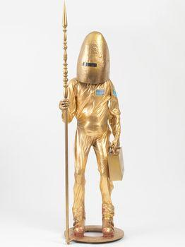 Nomo, 2009.  Metal, wood, sponge, old clothes, ski boots, and gold paint, approximately 90 1/2 x 27 1/2 x 27 1/2 in. The Dakis Joannou Collection, Athens