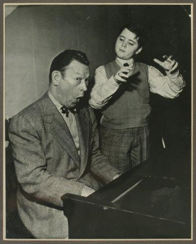 Robert White at age 10, with comedian Fred Allen on NBC.