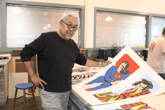Shimomura with two new prints at Lawrence Lithography Studio in Kansas City, Missouri.