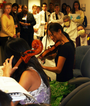 The Ahn Trio performs for patients and staff at Shands Hospital. Arts programs at hospitals cost little, but are often perceived by patients and visitors as a welcome luxury.