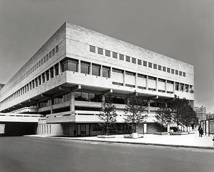 The original façade of the Julliard School was set back from the street by a large expanse of pavement (filling the triangle created by Broadway).