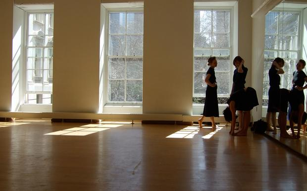 Dance New Amsterdam's bright, sunny space featuring floor to ceiling windows.