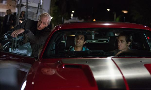 (Left to right) Writer and director Dan Gilroy with actors Riz Ahmed and Jake Gyllenhaal on the set of Nightcrawler
