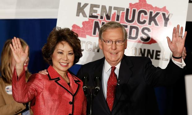 Senate Minority Leader Mitch McConnell (R-KY) and his wife Elaine Chao wave to supporters after a victory celebration following McConnell's victory in the Kentucky Republican primary.